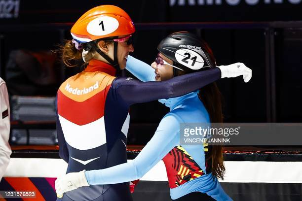 Netherlands Suzanne Schulting and Belgium's Hanne Desmet congratulate each other after Schulting won the 1000 meters final on the final day of the...