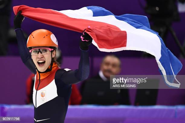 Netherlands' Suzanne Schulting celebrates winning the gold medal in the women's 1000m short track speed skating A final event during the Pyeongchang...