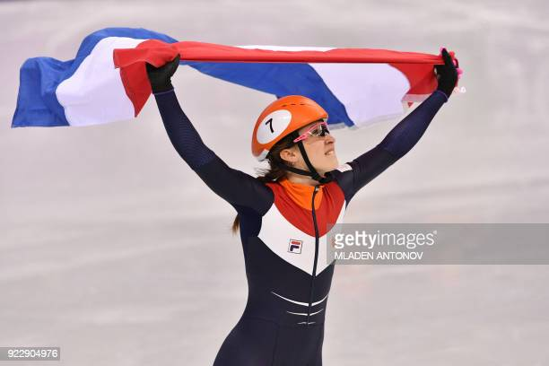 TOPSHOT Netherlands' Suzanne Schulting celebrates winning the women's 1000m short track speed skating A final event during the Pyeongchang 2018...