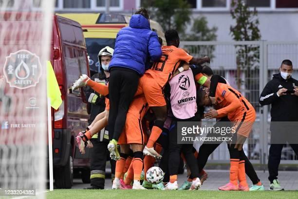 Netherlands' team celebrates their 2-1 victory during the UEFA Under21 Championship quarter-final football match Netherlands v France in Budapest, on...