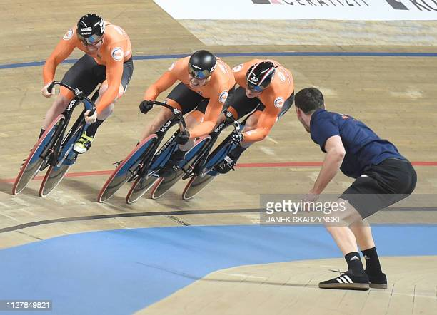 Netherlands' team compete to win gold during the men's team sprint final at the UCI Track Cycling World Championship in Pruszkow on February 27 2019...