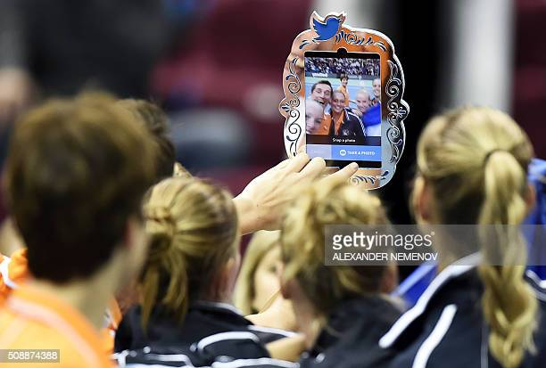 TOPSHOT Netherland's team makes a selfie after Kiki Bertens scored the third point of her team following her victory over Russia's Svetlana...