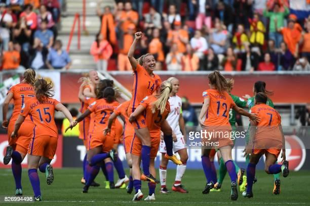 Netherlands' team players celebrate after winning the UEFA Womens Euro 2017 football tournament final match between Netherlands and Denmark at Fc...