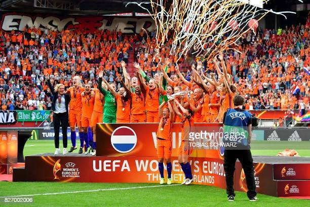 Netherlands' team players celebrate after winning the UEFA Womens Euro 2017 football tournament final match between Netherlands and Denmark at Fc...