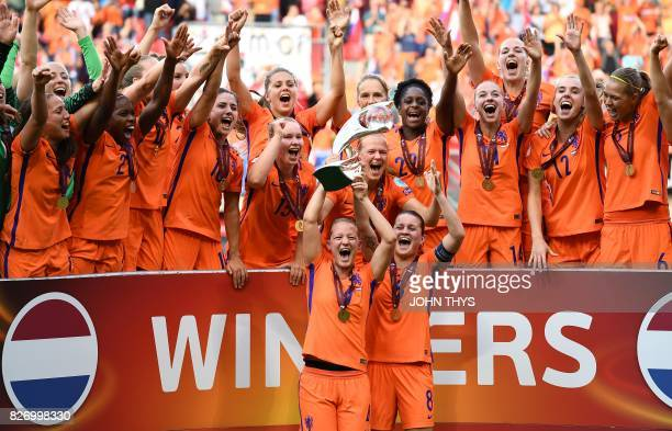 Netherlands' team players celebrate with the trophy after winning the UEFA Womens Euro 2017 football tournament final match between Netherlands and...