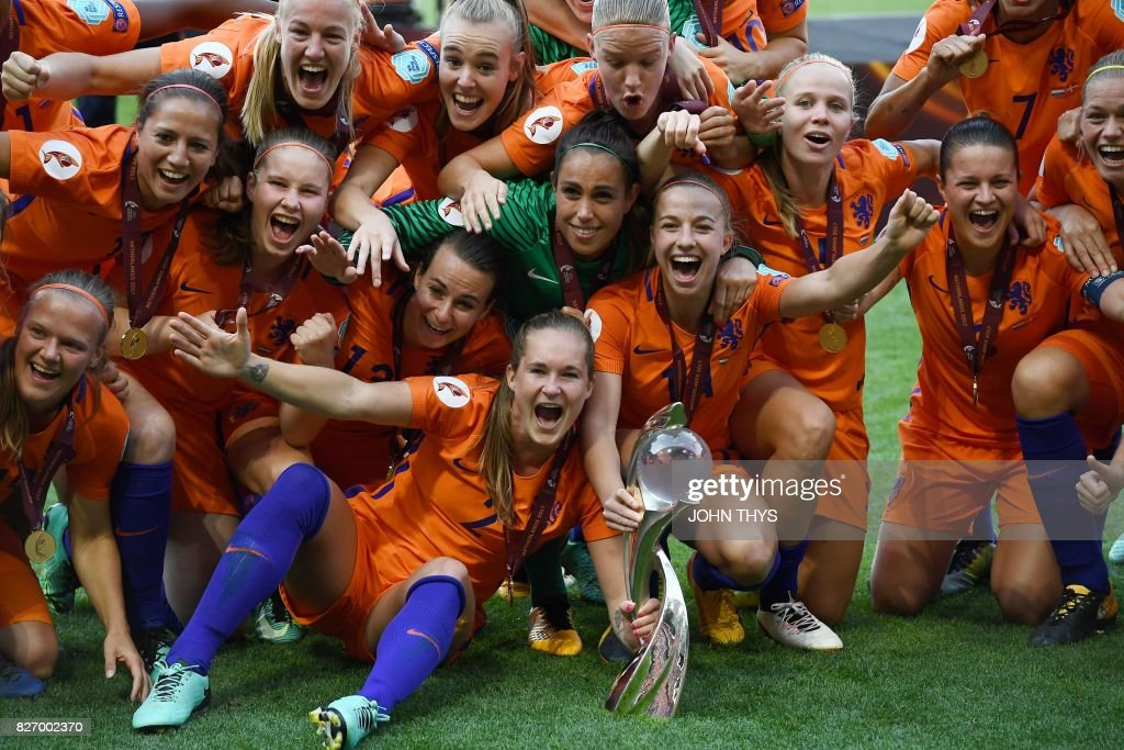 TOPSHOT - Netherlands' team players celebrate with the trophy after winning the UEFA Womens Euro 2017 football tournament final match between Netherlands and Denmark at Fc Twente Stadium in Enschede on August 6, 2017. /