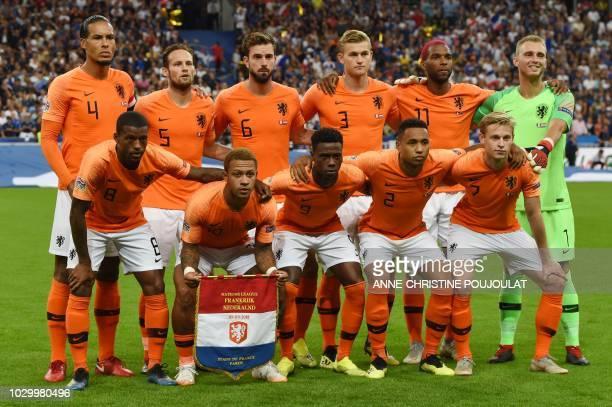 Netherland's team players Netherlands' midfielder Georginio Wijnaldum Netherlands' forward Memphis Depay Netherlands' forward Quincy Promes...