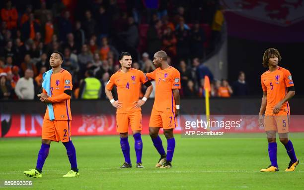 Netherlands' team players react following their FIFA World Cup 2018 football Group A qualification match between the Netherlands and Sweden at the...