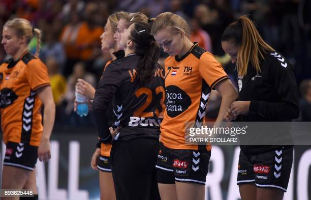 Netherlands' teamplayers react after they lost the IHF Womens World Championship handball halffinal match between Norway and Netherlands on December...