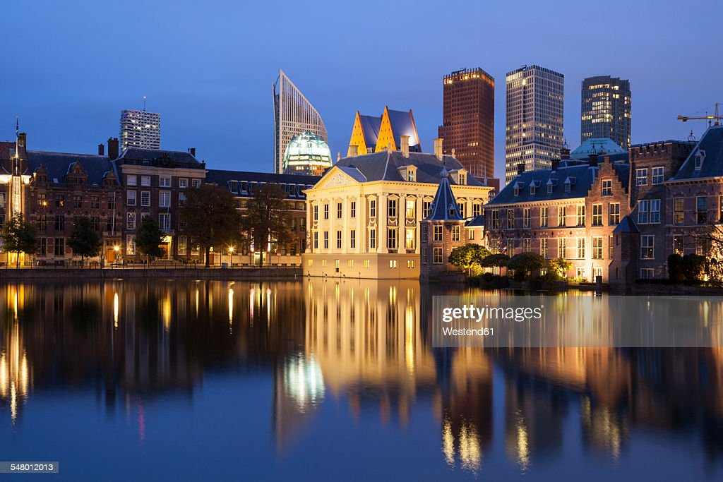 Netherlands, The Hague, Binnenhof, high rise buildings and Museum Mauritshuis at night : Stock Photo
