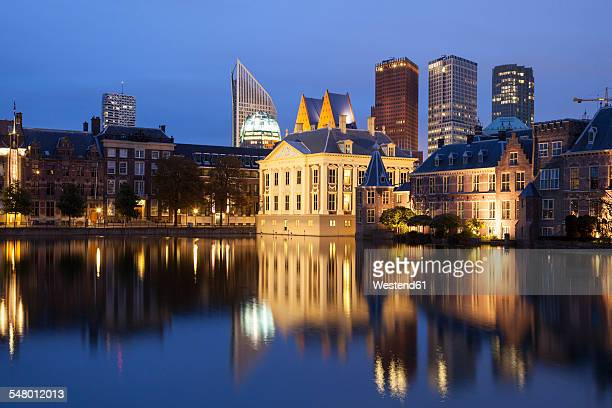 netherlands, the hague, binnenhof, high rise buildings and museum mauritshuis at night - binnenhof stock photos and pictures
