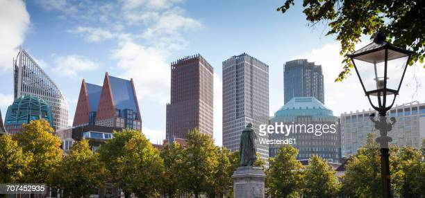 netherlands, the hague, view to skyline with monument of william of orange in the foreground - the hague stock photos and pictures