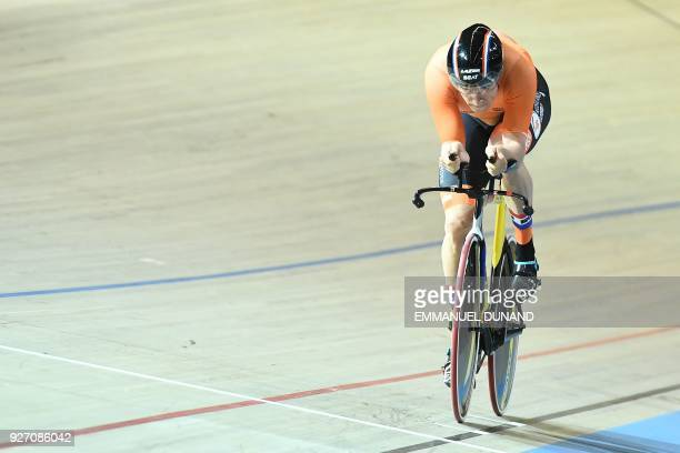 Netherland's Theo Bos takes part in the men's one kilometre time trial final during the UCI Track Cycling World Championships in Apeldoorn on March 4...