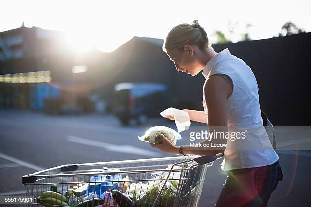 Netherlands, Tilburg, Woman checking shopping