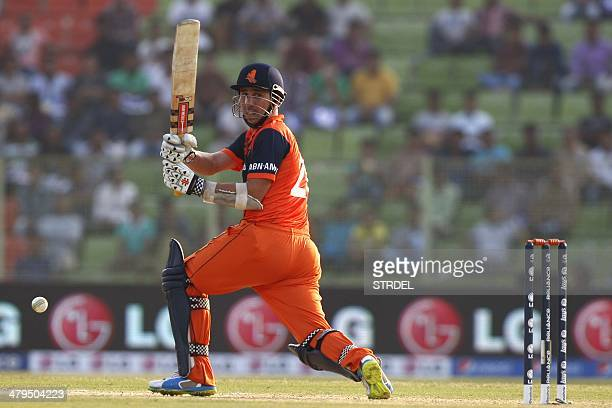 Netherlands' Tom Cooper plays a shot during the ICC T20 World Cup qualifying cricket match between the Netherlands and Zimbabwe at Sylhet...