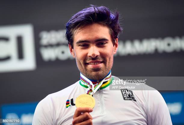 Netherlands' Tom Dumoulin celebrates with his gold medal after winning the men elite individual time trial at the UCI Cycling Road World...