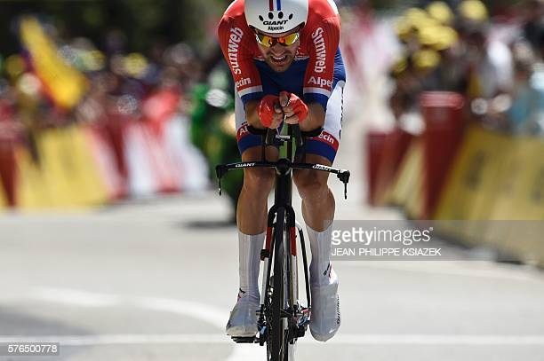 Netherlands' Tom Dumoulin crosses the finish line of the 375 km individual timetrial the thirteenth stage of the 103rd edition of the Tour de France...