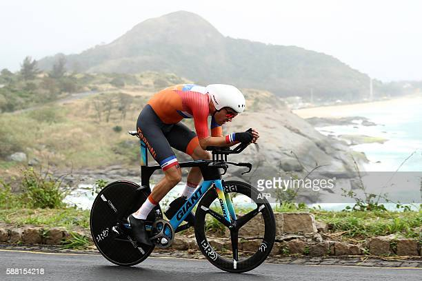 Netherlands' Tom Dumoulin cycles during the Men's Individual Time Trial event at the Rio 2016 Olympic Games in Rio de Janeiro on August 10 2016 / AFP...