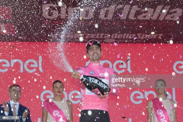 Netherlands' Tom Dumoulin of team Sunweb celebrates the pink jersey of the overall leader on the podium after winning the 14th stage of the 100th...