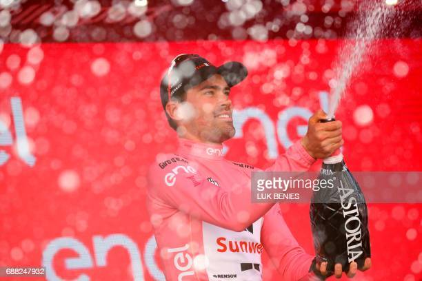 Netherlands' Tom Dumoulin of team Sunweb celebrates the Pink Jersey of the overall leader on the podium after the 18th stage of the 100th Giro...