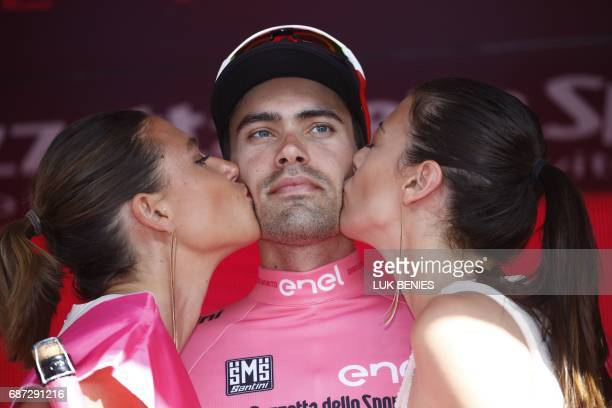 Netherlands' Tom Dumoulin of team Sunweb poses with the Pink Jersey of the overall leader on the podium after the 16th stage of the 100th Giro...