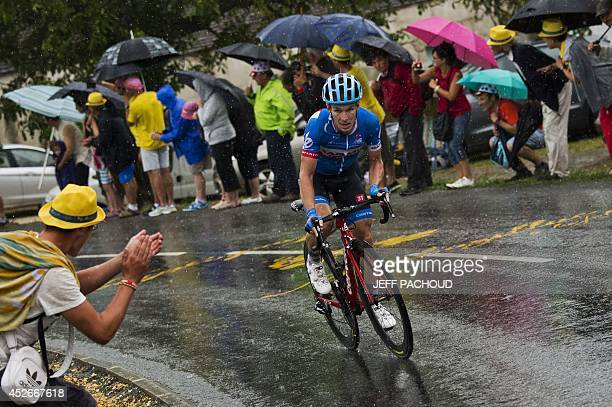 Netherlands' Tom Jelte Slagter rides in a breakaway under a heavy rain during the 2085 km nineteenth stage of the 101st edition of the Tour de France...