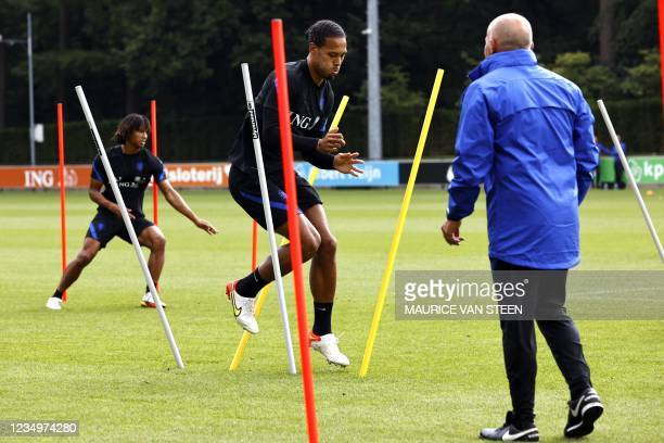 Netherlands' Virgil van Dijk takes part in a training session at the KNVB Campus as part of the preparation for the World Cup qualifying football...