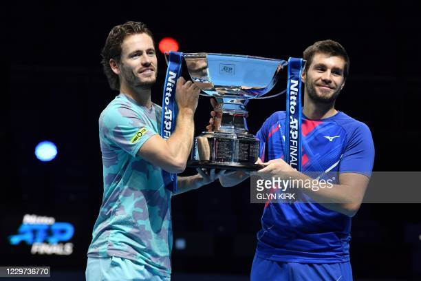 Netherlands' Wesley Koolhof and Croatia's Nikola Mektic pose with the winner's trophy after their 6-2, 3-6, 10-5 victory over Austria's Jurgen Melzer...