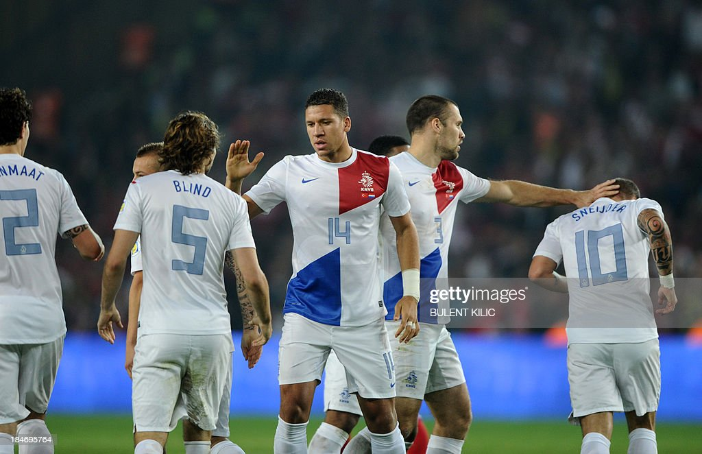 Netherlands' Wesley Sneijder (R) celebrates his goal with his teammates during the 2014 FIFA World Cup qualifying football match Turkey vs Netherlands on October 15, 2013 at the Sukru Saracoglu Stadium in Istanbul.