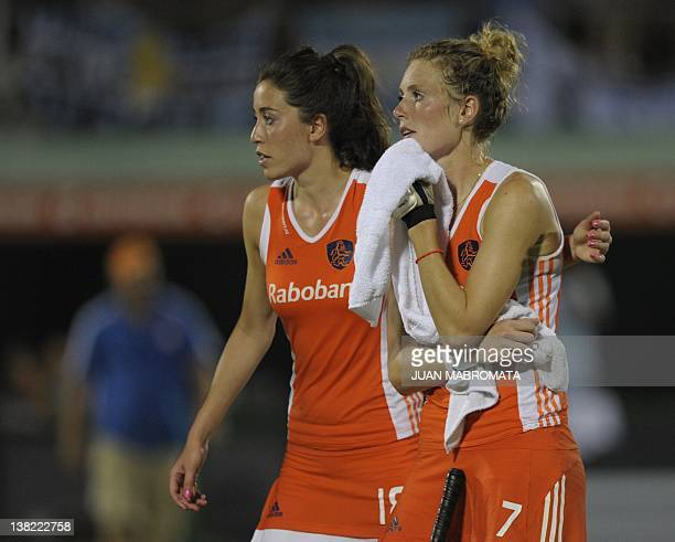 Netherlands' Willemijn Bos and Naomi Van As react after losing in a penalty shootout against Argentina their Champions Trophy 2012 semifinal field...