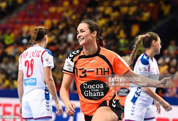 Netherlands' Yvette Broch celebrates after scoring a goal during the Women's European Handball Championship Group I match between Serbia and...