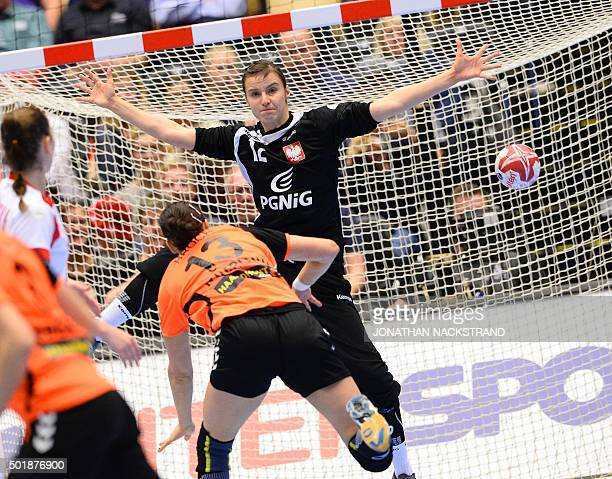 Netherlands Yvette Broch throws the ball to score past Polands goalkeeper Weronika Gawlik during the 2015 Women's Handball World Championship...