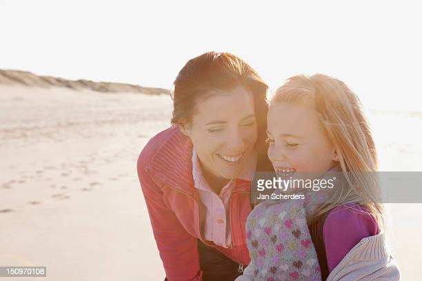 Netherlands, Zeeland, Haamstede, Mother with daughter on beach
