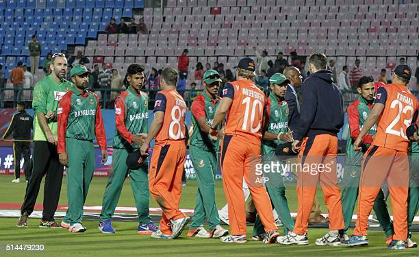 Netherlands's captain Peter Borren leads his players as they shake hands with Bangladesh opponents after the World T20 cricket tournament match...