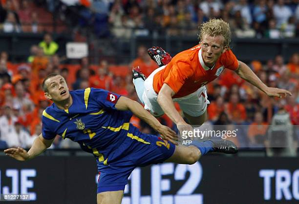 Netherlands's Dirk Kuyt scores 10 against Ukrainian defender Andry Nesmachniy during a friendly football match on May 24 2008 in Rotterdam AFP PHOTO...