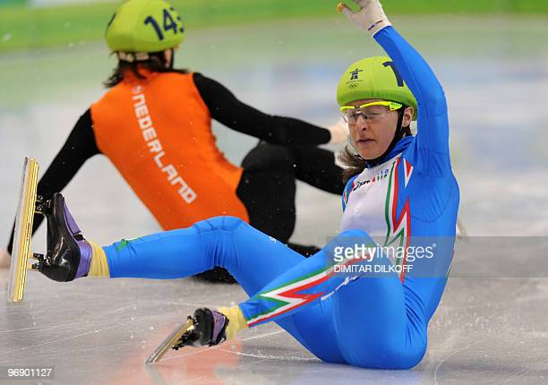 Netherlands's Jorien ter Mors is pictured with Italy's Cecilia Maffei after they felt down in the Ladies' 3000 m Short Track relay semifinal race at...