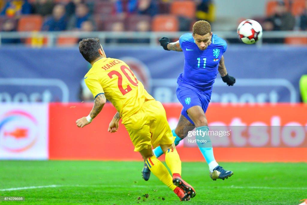 Netherlands's Memphis scores against Romania's Sergiu Hanca during International Friendly match between Romania and Netherlands at National Arena Stadium in Bucharest, Romania, on 14 november 2017.