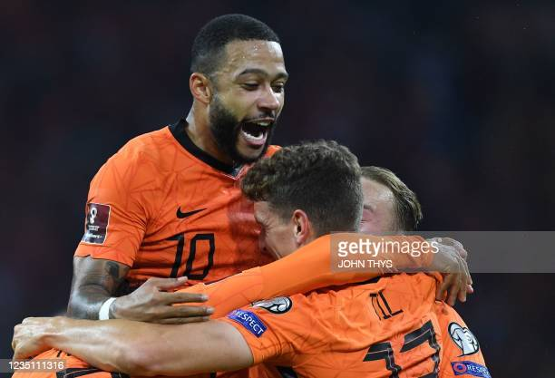Netherlands's midfielder Guus Til celebrates with Netherlands' forward Memphis Depay after scoring a goal during the FIFA World Cup Qatar 2022...