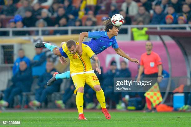 Netherlands's Nathan Aké vies Romania Denis Alibec during International Friendly match between Romania and Netherlands at National Arena Stadium in...