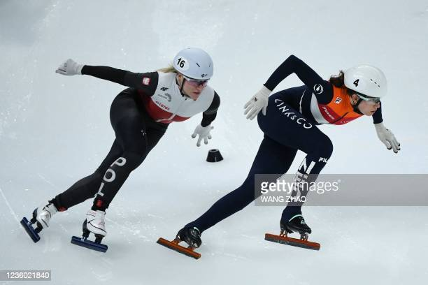 Netherlands's Selma Poutsma competes in the mixed team relay quarter finals during the 2021/2022 ISU World Cup short track speed skating, part of a...
