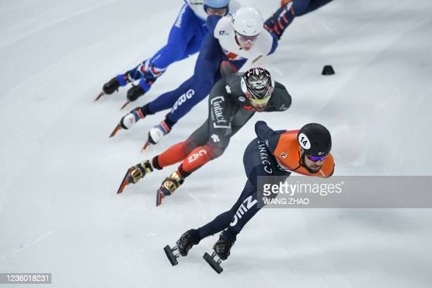 Netherlands's Sjinkie Knegt competes in the men's 1500m quarter finals during the 2021/2022 ISU World Cup short track speed skating, part of a 2022...