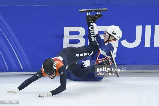 Netherlands's Sjinkie Knegt falls in the men's 1500m quarter finals during the 2021/2022 ISU World Cup short track speed skating, part of a 2022...