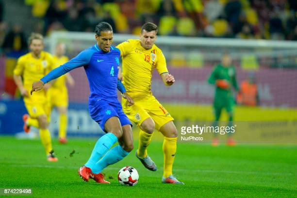 Netherlands's Virgil vies Romania's George Tucudean during International Friendly match between Romania and Netherlands at National Arena Stadium in...
