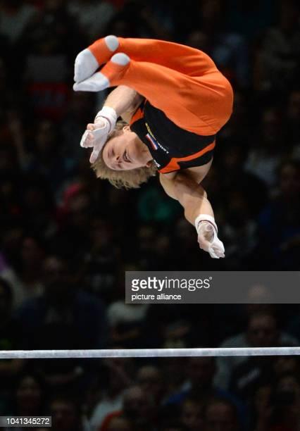 Nethetrland's Epke Zonderland performs on the horizontal bar during the Artistic Gymnastics World Championships in Antwerp Belgium 06 October 2013...
