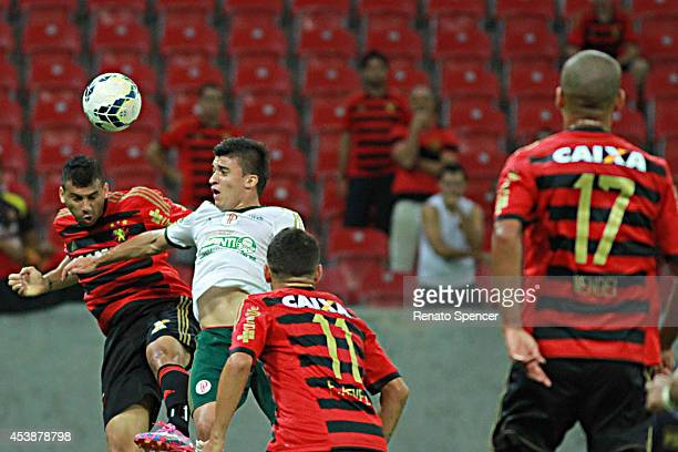 Neto Baiano of Sport Recife wins a header with Tobio of Palmeiras during the Brasileirao Series A 2014 match between Sport Recife and Palmeiras at...
