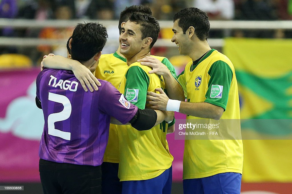 Neto #11 of Brazil (M) is congratulated by team mates after scoring a goal against Libya during the FIFA Futsal World Cup, Group C match between Brazil and Libya at Korat Chatchai Hall on November 4, 2012 in Nakhon Ratchasima, Thailand.