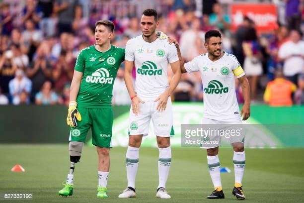 Neto of Chapecoense cries between his teammates Follmann and Alan Ruschel before the Joan Gamper Trophy match between FC Barcelona and Chapecoense at...