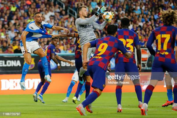 Neto of FC Barcelona makes a save on a corner kick against SSC Napoli during the first half of a preseason friendly match at Hard Rock Stadium on...