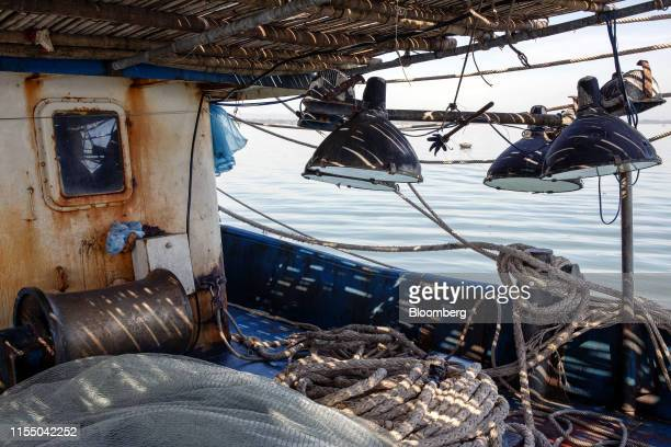 Nets and ropes sit onboard a fishing trawler anchored in Tam Quang harbor in Quang Nam province Vietnam on Wednesday June 26 2019 Fishermen are on...