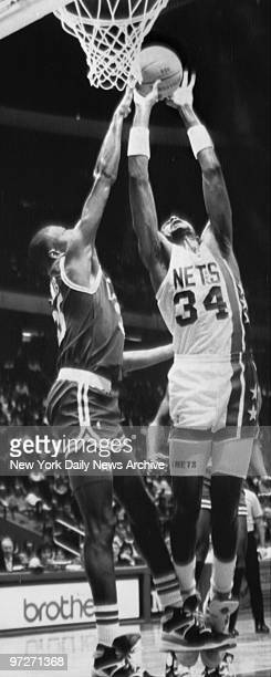 Nets' Chris Morris goes up for a layup as Celtics' Reggie Lewis and Kevin McHale try to block
